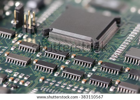 Green Circuit board with microprocessor and other electronic components - stock photo