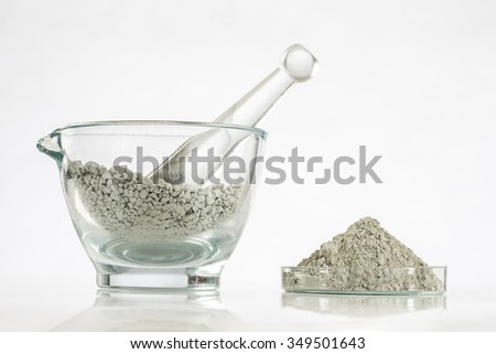 Green clay in glass mortar  - stock photo