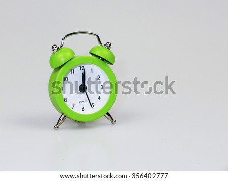 Green Clock isolated in white background - stock photo