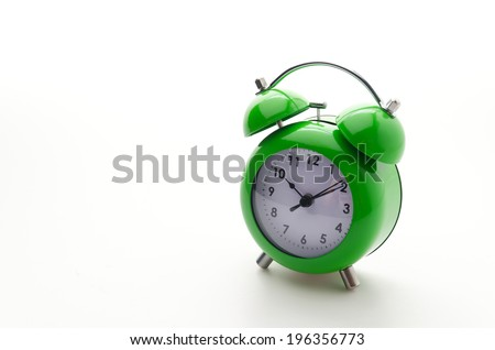 Green clock isolated on white - stock photo