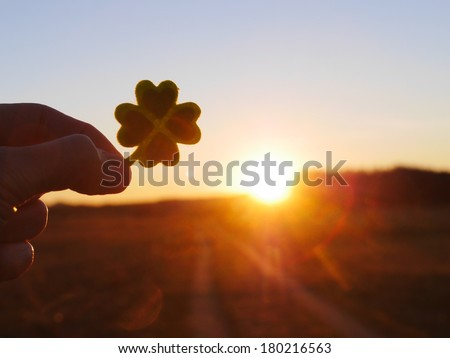 Green clover leaf with green hearts - stock photo