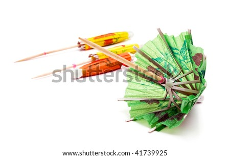 green cocktail umbrella with shadow - stock photo