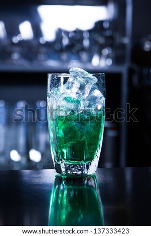 Green coctail with ice cubes - stock photo