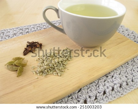 Green coffee with cardamom and cloves - stock photo