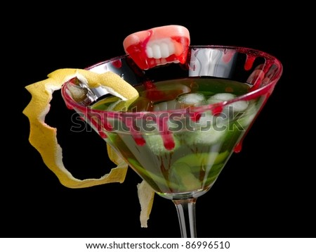 Green cold bloody cocktail with dry lemon rind - stock photo
