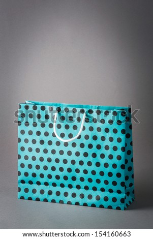 Green color with black dot paper shopping bag isolated on gray background - stock photo