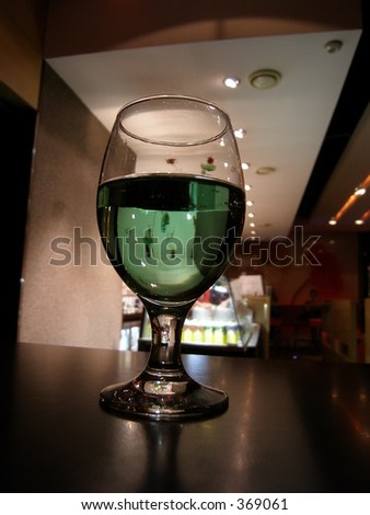 Green coloured cider - stock photo
