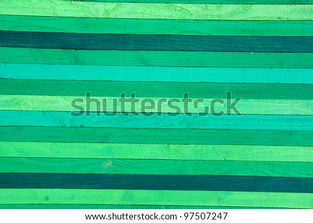 green coloured wooden wall.                 Creative colorful wall background - stock photo