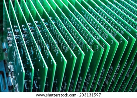 green communication circuit board closeup in a server room  - stock photo
