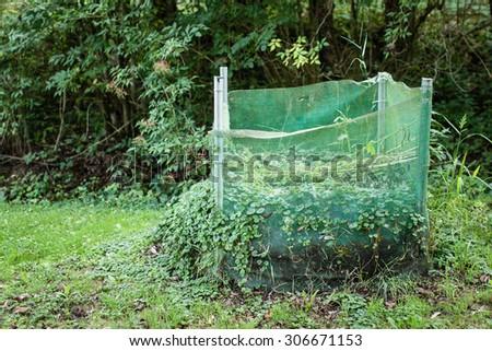 green compost box in garden. selective focus - stock photo