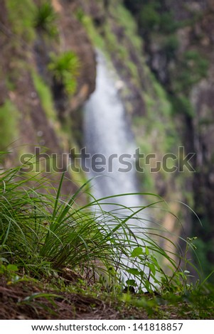 Green concept with waterfall in the background - stock photo