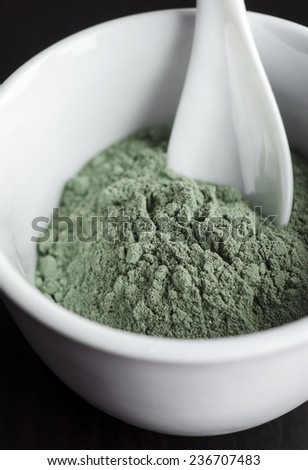 Green cosmetic clay in a bowl - stock photo