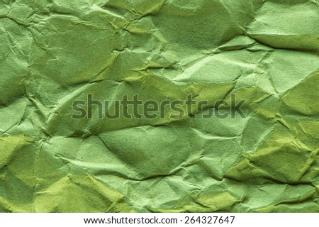 Green crepe paper background abstract. - stock photo