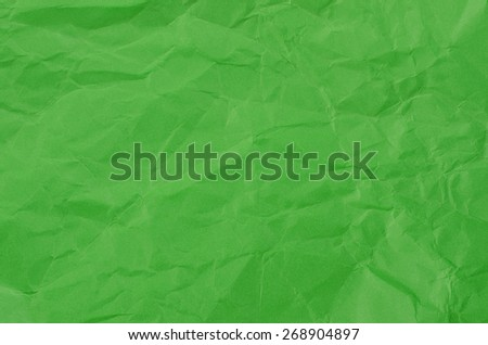 Green crumpled paper for texture or background. - stock photo