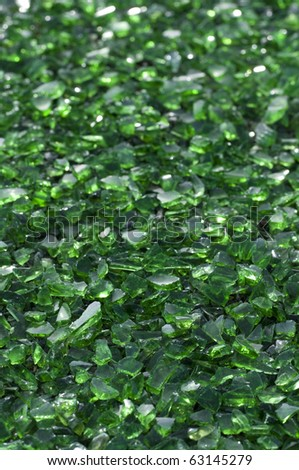 Green crushed glass ready for recycling - stock photo