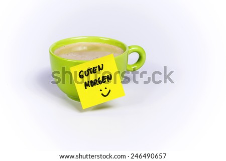 Green cup of coffee, organic coffee,note good morning - stock photo