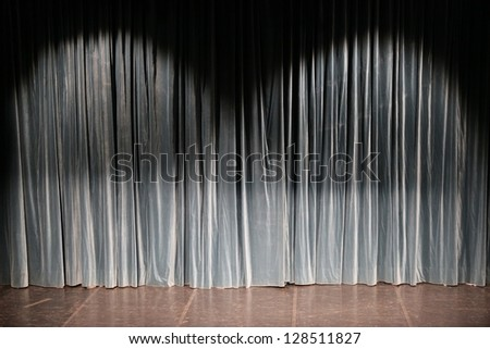 Green curtain in a theater with small part of the stage. - stock photo