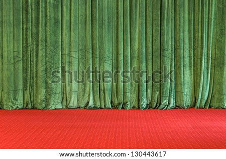 Green Curtains on a red Stage - stock photo