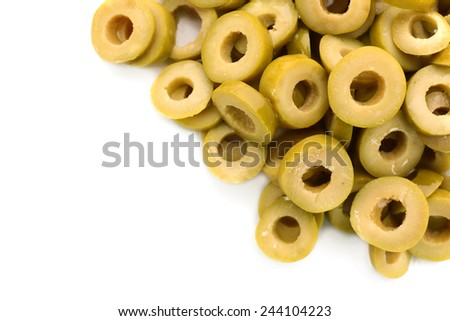 Green cut olive rings isolated on white - stock photo