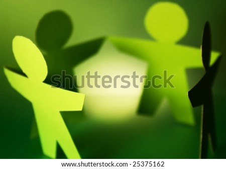 green cutouts of paper people - stock photo