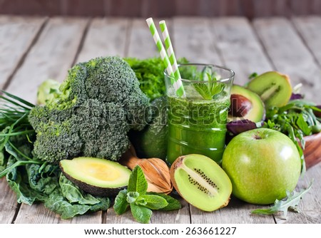 Green detox smoothie with raw vegetables and fruits - stock photo