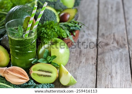 Green detox smoothie with raw vegetables and fruits. Copyspace background. - stock photo