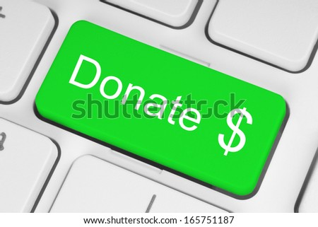 Green donate button on the keyboard close-up   - stock photo