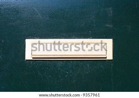 Green door with letterslot / mailbox - stock photo