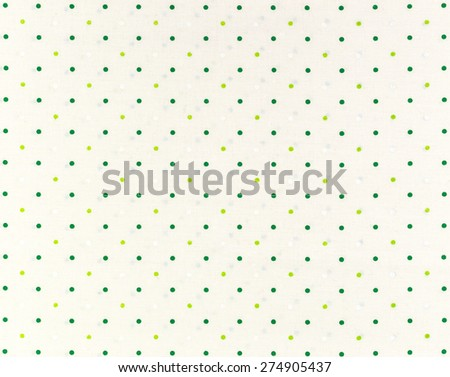 Green dots over white Polka dot fabric background and texture - stock photo