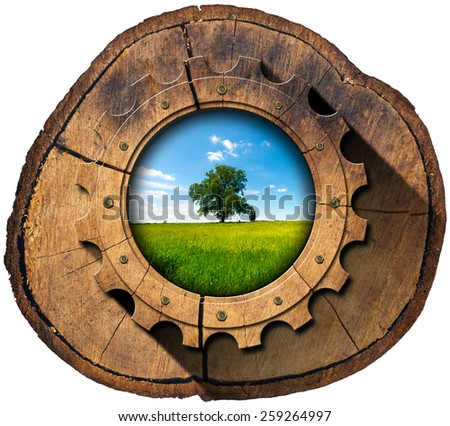 Green Economy - Tree Trunk and Gear. Wooden gear in a section of tree trunk with green tree in countryside, concept of green economy. Isolated on white background - stock photo