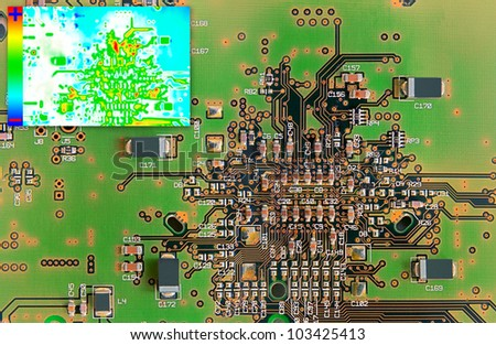 Green Electronic Circuit Board with Thermal Image Diagram for Failure Detection - stock photo
