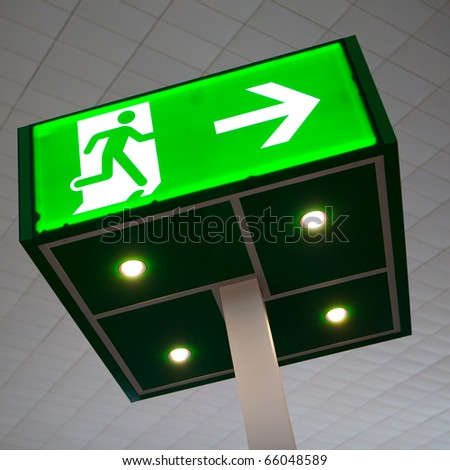 green emergency exit sign - stock photo