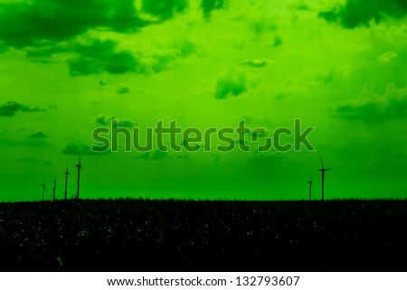Green Energy Concept Silhouettes Of Wind Turbines - stock photo