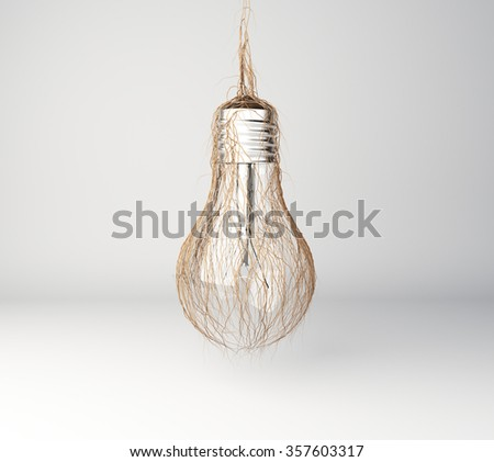 Green energy concept with lightbulb and grass - stock photo