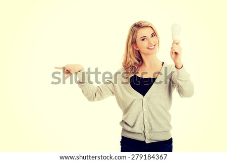Green energy concept. Woman with led light bulb showing copy space. - stock photo