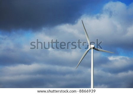 green energy with generated with wind will help to save the planet - stock photo