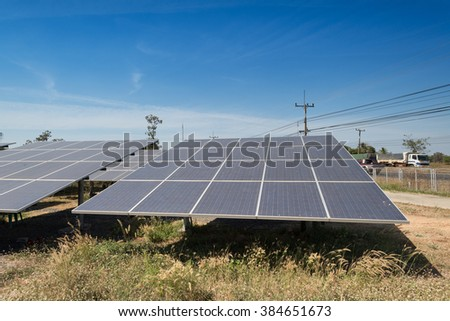 Green energy with solar panels outdoor as alternative power in renewable resource - stock photo