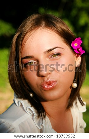 Green eye girl blowing a kiss - stock photo
