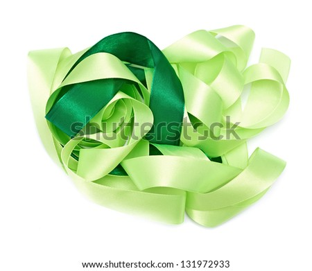 Green fabric ribbon on the white - stock photo