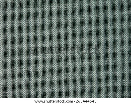 Green fabric texture useful as a background - stock photo