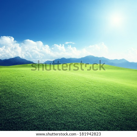 green field and mountains - stock photo