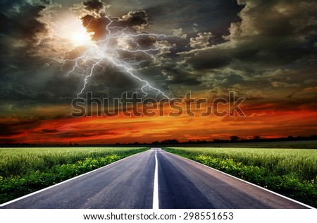 green field and road over blue sky  - stock photo