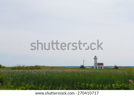 Green field and small house in Prince Edward Island - stock photo