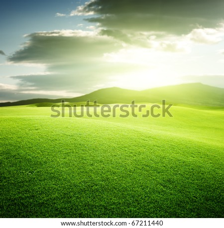 green field and sunset - stock photo