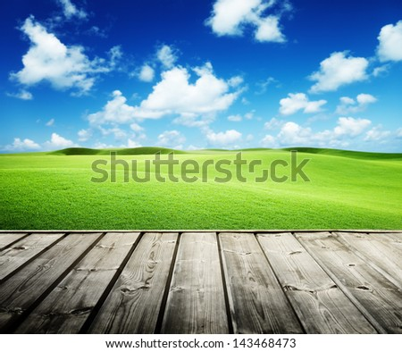 Green field and wood floor - stock photo