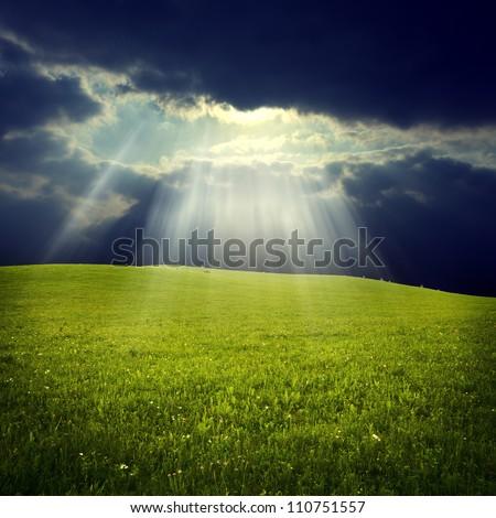 Green field with  jesus light - stock photo