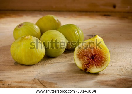 Green Figs on Wood - stock photo