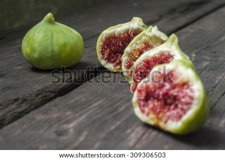 Green figs on wood background - stock photo