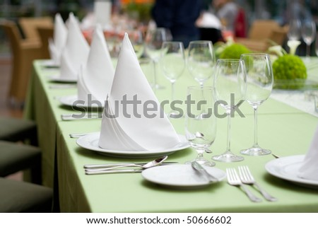 Green Fine Wedding Table Setting - stock photo