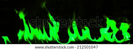Green flames on a black background. - stock photo